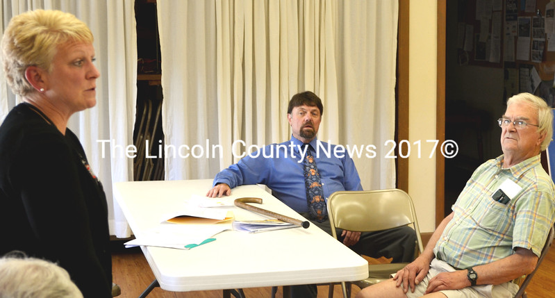 South Bristol Postmaster Wayne Benner, center, and town resident Ken Maguire, right, attended the July 18 community meeting conducted by Bath Postmaster Lori Boudin to set reduced post office hours for the South Bristol post office. (Tim Badgley photo)