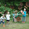 Nathan Nicholls' grandchildren (from left) Douglas Nicholls, 6, Barrett Nichols, 3, Liam Geis, 3, and Anabelle Geis, 6, play in the garden on Saturday. The children guided visitors around their grandfather's outdoor exhibits. Nicholls passed away suddenly last  week at the age of 52. (Eleanor Cade Busby photo)