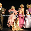 The Narrator (Joe McGrann) sets the stage as Stepsisters (standing, from left) Aspen Jones and Jane Bertlesen, with Donna Griffin as the Stepmother, sneer at Cinderella (Devin Domeyer). (Eleanor Cade Busby photo)
