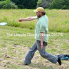 Jeff Hurd, one of the owners of Cider Hill Farm, plays a round of disc golf during Locavore. (D. Lobkowicz photo)