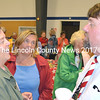 From left, sisters Susanne Nelis of South Bristol and Victoria Munsey of Torre Pellice, Italy, visit with South Bristol Postmaster Wayne Benner at his retirement party at the South Bristol School July 16. (Tim Badgley photo)