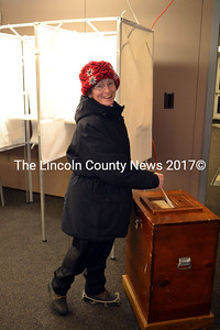 Dressed for the cold weather Tuesday, Jan. 7, Pat Maguire casts her vote for school board at the Wiscasset Community Center. (Kathy Onorato photo)