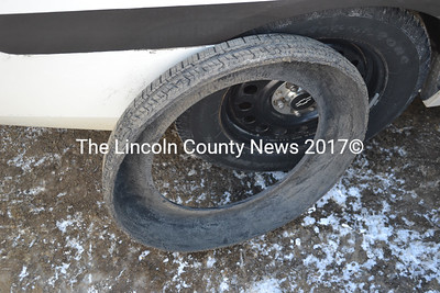 Lincoln County Sheriff's Deputy Mark Bridgham recovered this half of a tire after a silver sedan reportedly struck a utility pole in Bremen and left the scene at a high rate of speed. (D. Lobkowicz photo)
