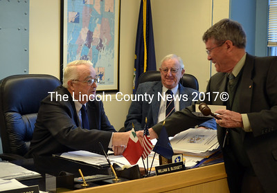 Lincoln County Administrator John O'Connell (right) presents the gavel to Commissioner William Blodgett who was relected to serve as chairman of Lincoln County's Board of Commissioners Jan. 7. (Kathy Onorato photo)