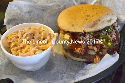A barbecue burger - a $10 burger with homemade barbecue sauce, bacon, smoked cheddar cheese and candied jalapenos - straight off the grill at The Shack in Waldoboro with a side of bacon cheddar coleslaw. (D. Lobkowicz photo)