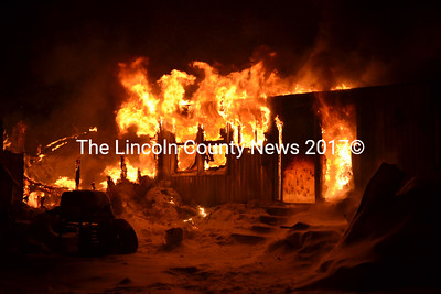 Flames pour out of a burning mobile home in Waldoboro Jan. 2. (D. Lobkowicz photo)