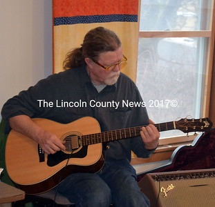 Guitarist Matt O'Donnell provides dinner music at the Feed Our Scholars spaghetti supper April 5.  (Kathy Onorato photo)