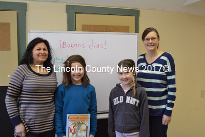 """Seeds of Knowledge Education Center holds a Spanish Class at Wiscasset Scout Hall Monday morning. Left to right,  Spanish teacher Lissehe Griffin, students Iris Pope and Julia Truesdell, and co-owner Lisa Truesdell.  One of their first lessons was to learn how to say """"Good Morning"""" in Spanish """"i Buenos dias!"""" (Charlotte Boynton photo)"""