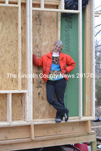 Linda Murray, of New Harbor, stands in what will be the front door of the home she is building herself. (Charlotte Boynton photo)