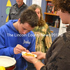 Genna Cherichello holds a plate while student Joshua Raymond takes a piece of fig to taste. (D. Lobkowicz photo)