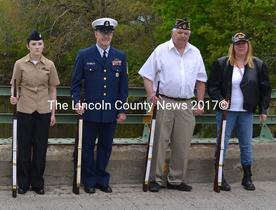 From left, Petty Officer 3rd Class Zakia Thiesen, Navy; Chief Barry King, retired Coast Guard; Petty Officer 3rd Class Tom Murphy, a disabled Navy veteran; and Specialist 4P Sandra Fowler, a disabled Gulf War Army veteran; stand at order arms prior to giving a three-volley rifle salute. (D. Lobkowicz photo)