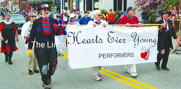 Members of the performance group Hearts Ever Young march and sing in the Twin Villages Memorial Day parade. (Tim Badgley photo)