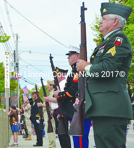 Representatives of the four branches of the U.S. military prepare for the annual gun salute at the Damariscotta-Newcastle bridge during the Twin Villages Memorial Day parade. (Tim Badgley photo)