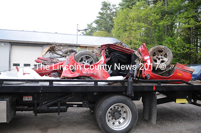 A 1989 Chevrolet Camaro sits on a flatbed at Quick Turn Auto Repair and Towing in Damariscotta the morning of Memorial Day, Monday, May 26. The driver was in critical condition after an accident late May 25. (Paula Roberts)