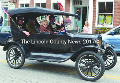 South Bristol resident John Harris and his passengers ride in style at the Twin Villages Memorial Day parade. (Tim Badgley photo)