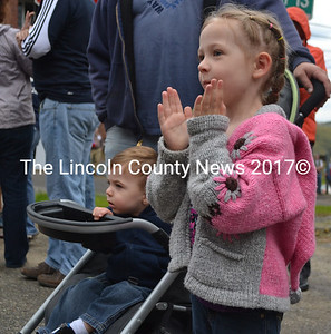 Isabella Whitehouse, 5, and her little brother Maxfield Johnson, 19 months, look on as the Memorial Day parade moves by. (D. Lobkowicz photo)