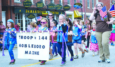 Brownies in Nobleboro Girl Scout Troop 144 march in the Twin Villages Memorial Day parade. (Tim Badgley photo)