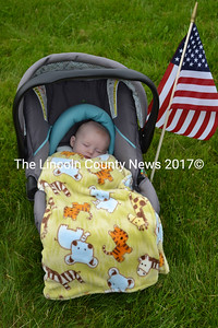 Emery Wyatt Footer was presented an American flag as the youngest person at the Memorial Day observance in Wiscasset. (Charlotte Boynton photo)