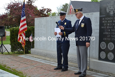 The Rev. Wally Staples (left) and American Legion Post Cmdr. William Cossette lead Wiscasset's Memorial Day observance at the veterans monument May 26. (Charlotte Boynton photo)