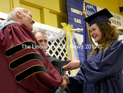 Amanda Gustafson smiles broadly as she receives her diploma from interim Superintendent Michael Cormier. (D. Lobkowicz photo)