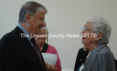 Eliot Cutler talks with Lola O'Byrne, of East Boothbay, during a reception at the Southport Town Hall, Tuesday, June 17.