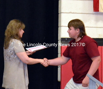 Wiscasset High School English teacher Michelle Fraser presents an award to Nathan Haley June 12. (Kathy Onorato photo)