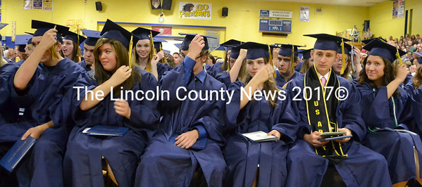 Medomak Valley graduates move their tassels in a symoblic gesture after receiving their diplomas. (D. Lobkowicz photo)