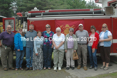 The Brann and Crummett families gather to see the dedication of the new Somerville Fire Truck. The truck was purchased by the Brann familiy and outfitted by the Cummetts in memeory of Cecil Brann who was a founding memeber of the department. (Eleanor Cade Busby photo)