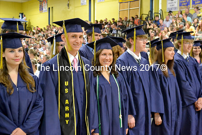 From left, graduating seniors Danielle Leigh, Bandon McAuliffe, Elly Baubonis, Anthony Betts, Jennica Smith, and Devon Mank stand after marching into the gymnasium at Medomak Valley High School. (D. Lobkowicz photo)