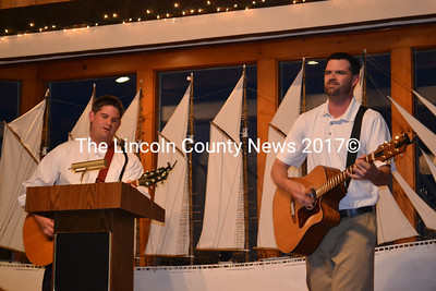 Steve Bleile (left) and his brother Eric Bleile perform a few country tunes at their mother's retirement party June 13. (Kathy Onorato photo)