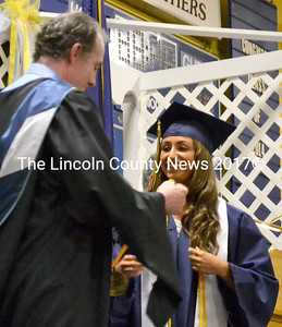 Brooke Benedict receives the valedictorian medal from Assistant Principal Andrew Cavanaugh. (D. Lobkowicz photo)