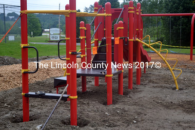 The installation of the monkey bars and slide will complete the phase one construction of the new Whitefield Elementary School playground. (Kathy Onorato  photo)
