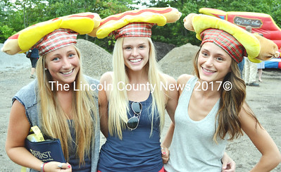 Sporting hot dog hats, from left, Carney Hamilton, Molly Stackhouse, and Ally Barnes join in the fun at the 2014 Hot Dog Eating Contest held at Stackhouse Landscaping in Bristol July 3. (Tim Badgley photo)