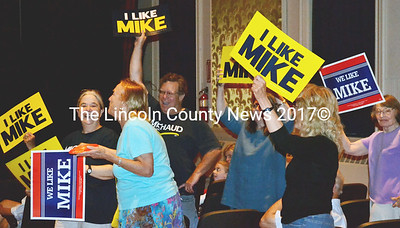 """Chanting, """"We want Mike!"""" attendees at the Lincoln County Democrats gubernatorial rally cheer their candidate Mike Michaud to the stage at the Lincoln Theater in Damariscotta July 7. (Tim Badgley photo)"""