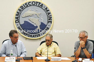 Newly elected Damariscotta Selectmen James Cosgrove, left, and  George Parker, center, settle in at their first board meeting July 2 with board chair Ronn Orenstein, right. (Tim Badgley photo)