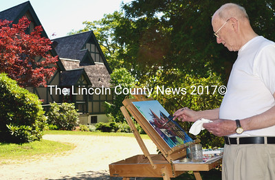 Dick Yerrington of Pemaquid Point, a member of Plein Air Painters - The Real Thing, at work on his painting of St. Andrew's Episcopal Church in Newcastle, July 11. (Tim Badgley photo)
