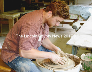 Watershed Center for the Ceramic Arts artist-in-residence Stuart Gair making one of the 500 plates for the 2015 Salad Days fund raiser in Newcastle July 12. (Tim Badgley photo)