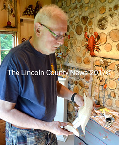 Daniel Strawser holds a roughed-out basswood bird. He will use a pocketknife to finish the carving. (D. Lobkowicz photo)