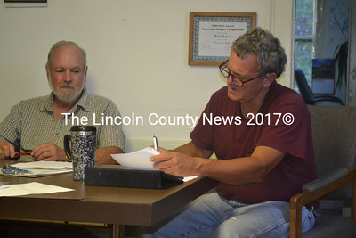 Alna Selectmen (from left) David Abbott and David Reingardt sign the new contract with the Wiscasset Transfer Station July 9. (Kathy Onorato photo)