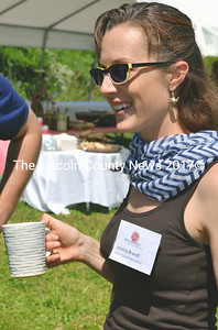 Creator of the 2014 Salad Days plates Jessica Brendl enjoys a cold drink at the annual Watershed Center for the Ceramic Arts fundraiser in Newcastle July 12. (Tim Badgley photo)