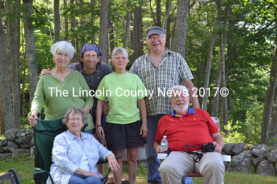 After a visit to Little Oak Island, Sarah and Ron Pierce, seated, take a break with their hosts on Westport Island, before going  on to visit with other friends. Shown from left to right, standing: Carol Bodmer, son Dan Bodmer, Donna Curry, and Gerald Bodmer.  (Charlotte Boynton photo)