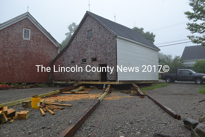 Having repaired its rotten sills, Jim Derby will use rollers to move this barn about 45 feet diagonally away from its location alongside Washington Road. (D. Lobkowicz photo)