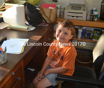 Alden Reingardt, son of Alna Selectman David Reingardt, spends time at th Alna Town Office, while his dad takes care of town business July 9. (Kathy Onorato photo)