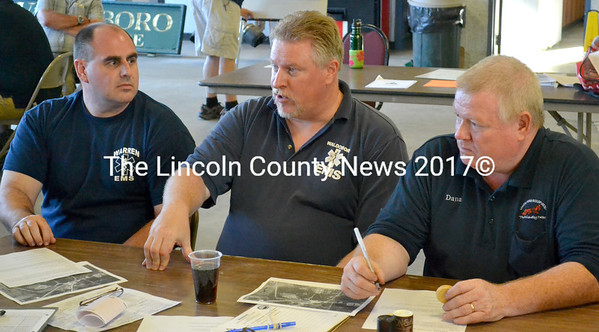 Waldoboro Emergency Medical Services Deputy Director Mike Poli (center) discusses a train derailment scenario July 10. Poli is flanked by Dana Dyer (right), an emergency medical technican for Waldoboro, and Bob Wood, assistant EMS director for Warren. (D. Lobkowicz photo)