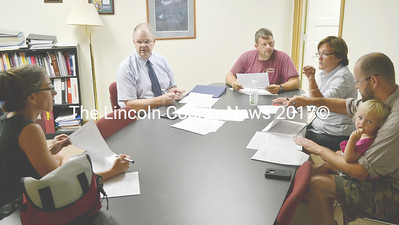 The Damariscotta School Committee met for the first following the annual town meeting at AOS 93 district  offices July 14. Shown from left, first-term member Angela Russ, Supterintendent Steve Bailey, Brent Hallowell, AOS 93 Business Manager Kati Hunt and Conor Smith, holding his daughter. (Tim Badgley photo)