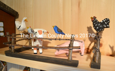 These small carved barnyard animals and birds were created by Daniel and Donna Strawser and are on display in The Cord Wood Gallery, at their home on Biscay Road in Bremen. (D. Lobkowicz photo)