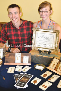 Alexander and Abigail Braley of Abigail Designs in Waldoboro display their jewelry at Arts at the Schoolhouse fundraiser in Round Pond July 26. (Tim Badgley photo)