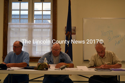 Dresden Selectmen (from left) Allan Moeller, Gerald Lilly, and Phil Johnston sign a contract with Cromwell Coastal Properties to sell five tax-acquired properties. (Charlotte Boynton photo)