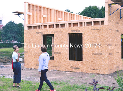 At the invitation of developer Xavier Cervera, Newcastle Selectmen Pat Hudson (left) and Carolyn Hatch (right)  view the new construction of a boat house on the Damariscotta River jetty prior to the board's meeting July 28. (Tim Badgley photo)