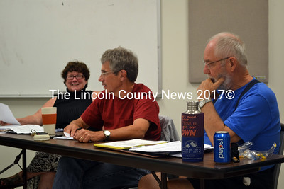 Whitefield Selectmen, from left, Sue McKeen, Tony Marple and Frank Ober discuss town business July 29. (Kathy Onorato photo)